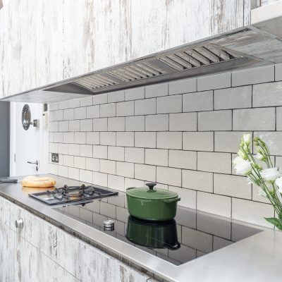 Vintage Finish Cabinets and Stainless Steel Worktop