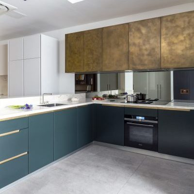 Brass and Bold Green Kitchen Cabinets Showroom